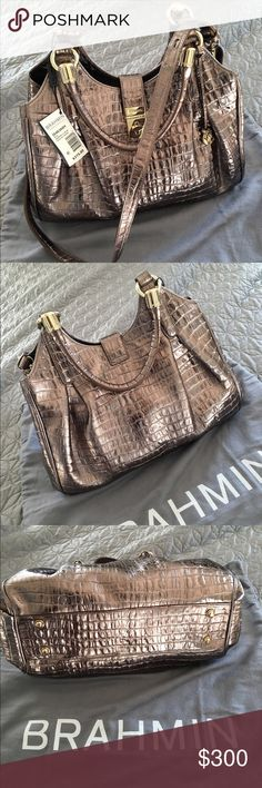 """Brahmin Elisa Pewter LaScala Leather Bag This sophisticated shoulder/handbag has more than enough room for your daily essentials. Pyrite pewter embossed leather. Double handles. Detachable adjustable leather strap. Gold tone hardware. Turnlock closure. Footed bottom. Center zip divider. Dust bag included. Approx. size: 14""""Wx13""""Hx7""""D. Strap drop 13"""", handle drop 8"""". Excellent condition. Brand new. Unused. Brahmin Bags"""