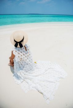 A roundup of the best blogger beach style for summer fashion inspiration | lace maxi dress and summer hat on @garypeppergirl