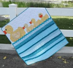 Lucky Ducks Baby Quilt - This looks really cute! Looks like an easy and quick baby quilt to make as a gift.
