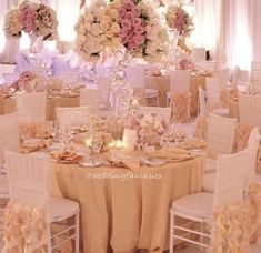 White, cream, and vintage pink reception table settings