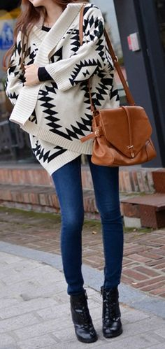 aztec. They have sweaters similar to this one at Jc Penny and I'm dying for one to wear when it's cold on the porch and I'm sitting out there reading. Great for a day like today!!