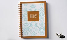 Blue notebook with DREAMS inscription and gold frame by Sloshe, $4.50