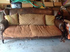 Leather sofa with down cushions (must be replaced!); Dimensions: 7 ft 2in long, 44 in deep, 38 in tall