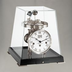 Hermle W23012 Tellurium 365 Day Calendar with 24 Hour Rotating Earth and Orbiting Moon. Nickel Plate W340 Movement on Black Timber Base with Key Drawer. All Displayed Perfectly under Mineral Crystal Glass Case.
