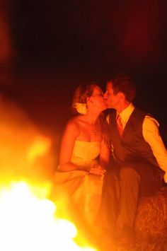 Sitting on bales of hay, kissing by the fire at your fall/country wedding. Cleopatra Photography
