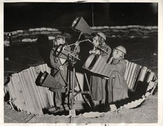 1940- Sound-locator crew in their sunken sandbagged emplacement of searchlight defense unit in London.