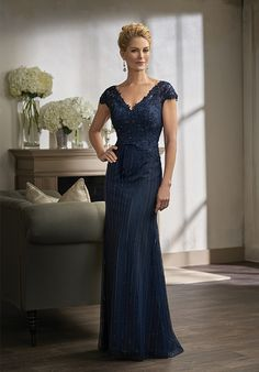Netting/Lace with Stretch lining dress with a lace and beaded bodice and beading on the front and back of skirt - all in the color navy.
