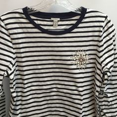 """J Crew Top black stripes navy blue color In perfect condition  very soft I don't see a tag with the materials.  Length is 23  17"""" across  sleeves are 18"""" all stones in place. It's hard to tell that the color is navy blue and the stripes are black. J. Crew Tops"""
