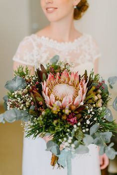 Hannah's bouquet bloomed beautifully on her wedding day and we love how neutral yet radiant the colours in her bouquet were.  TIP: If you ever want to preserve a bouquet similar to Hannah's, all that you have to do is leave it out of the water and let it stand in a vase or bucket to dry. Photographer: Julia Winkler Photography Preserve, Floral Wreath, Neutral, Wedding Day, Bucket, Bloom, Vase, Colours, Wreaths