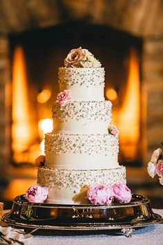 Simple and glam white, gold and pink wedding cake