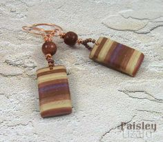 Antelope Canyon earrings on sand background