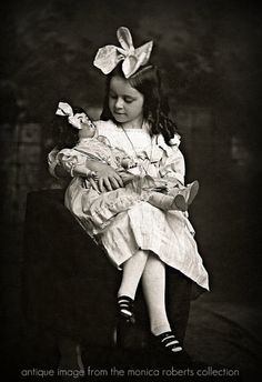 antique photo of girl with doll