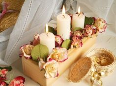Candles and dried roses arrangement