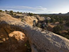 Mountain bikers in Moab, Ut. ....(Sun Valley was named one of the top 10 Mountain bike Towns in America!) :))) You may also enjoy my other board La Dolce in Sun Valley...My Home!~L