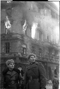 Red Army officers near a burning palace.Location unknown.Western-Europe.WW2