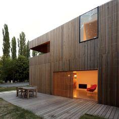 terrasse et ouverture sur pièce de vie- maison bois contemporaine par Avenier Cornejo - Orsay, France
