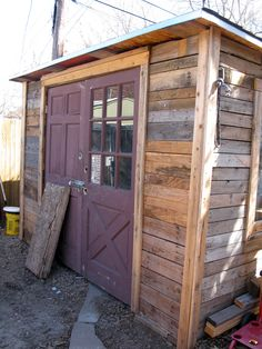 Built from junked shipping pallets, old windows, and doors. This is recyling at it's best