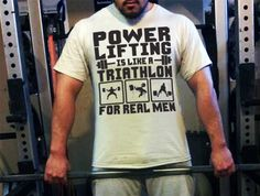 AVAILABLE ONLY AT http://physicalculturist.ca/powerlifting-triathlon/ Powerlifting is like a triathlon... for me. A funny shirt for powerlifters! powerlifting apparel.
