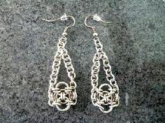 Келтски обици Камелот са изработени от сребриста медна тел. Дължина 6,5 см. Те са изплетени от халкички