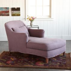 "MIRABELLE SLIPCOVER CHAISE -- Just delicious, the languid comfort afforded by this clean-lined chaise, smoothly slipcovered in plum linen. Ideal for reading and relaxation, its sink-unto comfort comes from plump soy-based foam cushions, plus an extra 24""W x 14""H lumbar pillow. FSC-Certified maple frame, flexible webbing construction. Made in USA. 36""W x 65""L x 34""H. (Paintings by Katherine Dunn.)"
