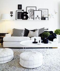 salon moderne en blanc et noir avec tapis gris