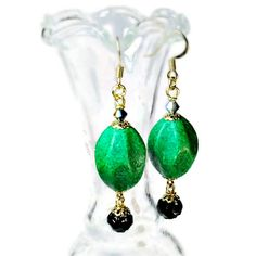 These unique vintage style retro earrings are made from the coolest emerald green15x19mm oval vintage Baroque lucite beads accented with black #gifts $15