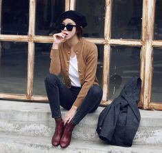 Skinny jeans, white t-shirt, brown or burgundy leather ankle boots, tan or beige cardigan, charcoal grey coat / jacket / blazer