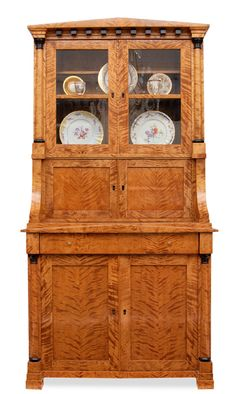 A Biedermeier glass cabinet    German, c. 1820/30. Flammed birch veneered and…