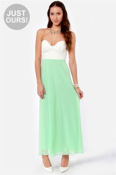 The Pastel-Tale Heart Mint Green Maxi Dress tells the story of a fashionable young woman and her passion for great dresses, with mint chiffon falling into maxi-length skirt that's fit for a fairytale! Ivory lace bustier bodice throws in a little drama with sweetheart-shaped cups that have boning in the centers. Hidden back zipper. Fully lined.