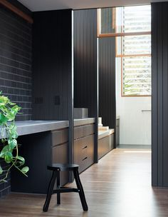Office nook with wall cladding & charcoal brick. Maybe a little too dark but like the mix of textures.