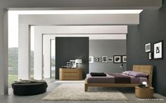 Serene Bedroom Furniture Ideas with Black Combined Gray Wall Paint Color and Gray Wooden Floor also White Square Carpet Area and Wooden Frame Bed and Rustic Wooden Headboard Design also Vanities