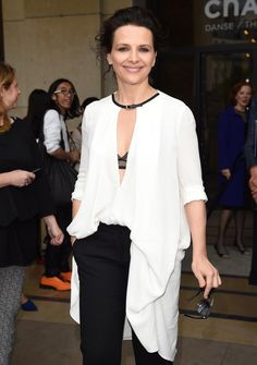 Juliette Binoche looks effortlessly beautiful as she leaves the Giorgio Armani Prive show on July 8, 2014.