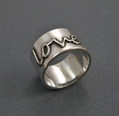 Sterling Silver Love Ring - Wide Band Ring - Word Ring. $120.00, via Etsy.