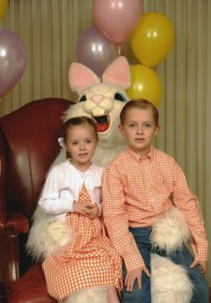 I never thought the Dept. Store Easter Bunny photos ever came out all that well - this one looks like he's ready to take a bite out of her head!