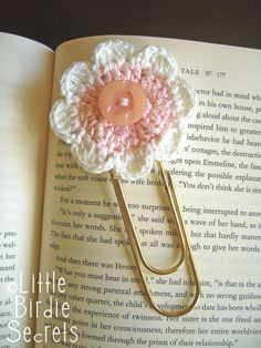 Seven-Petal Crochet Flower Pattern, makes cute book clip but could take this idea in a dozen different ways--crochet a tail for a book mark, attach to a ponytail elastic, hot glue to a magnetic disc for a fridge magnet, etc.  Great for stocking stuffers.