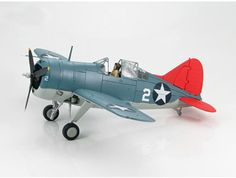 """This Brewster Buffalo F2A-3 `White 2` (NAS Miami 1940) Diecast Model Airplane features working propeller. It is made by Hobbymaster and is 1:48 scale (approx. 20cm / 7.9in wingspan).    General Background The Brewster F2A Buffalo was USN's first mono-wing fighter. The status of the """"Buffalo"""" is somewhat controversial in the history of aviation. It was designed by US but saw its real success only in Finland, a co-belligerent of Germany during WWII. It was designed as a carrier based fighter…"""