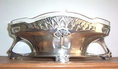 Art Nouveau polished silver plate on pewter  centerpiece flower dish , designed by the famous German artists Frederick Alder  for the URANIA company, Ca 1906.
