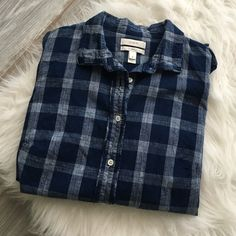 J.Crew boy shirt in indigo plaid this item is used, very good condition. Cotton, long sleeves. Functional buttons at cuffs. Machine wash. Tailored fit. Worn 1-2 times in excellent condition.  No trades. All sales final. J. Crew Tops Button Down Shirts