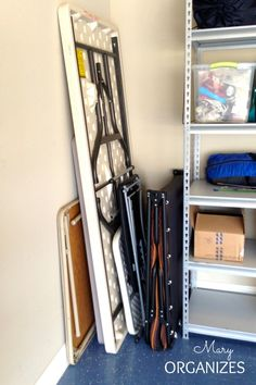 How to store folding tables, folding chars, camping cot, in the garage.  The folding tables and camping cot are stored up against the wall in the corner.  Garage Organization for Real Families - See more at: http://maryorganizes.com/2013/06/garage-organization-for-real-families/#sthash.GbiW2BLx.dpuf Garage Organization for Real Families