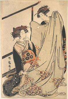 Two Beauties Looking at Kimono  Isoda Koryûsai  (Japanese, 1735–1790)  Period: Edo period (1615–1868) Culture: Japan Medium: Polychrome woodblock print; ink and color on paper