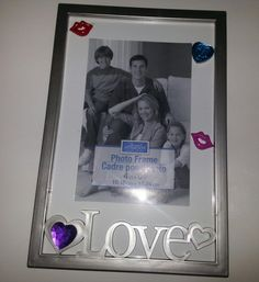 Check out this item in my Etsy shop https://www.etsy.com/listing/212702585/hand-decorated-jeweled-picture-frame