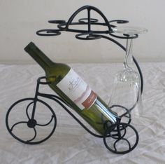 Wine glasses and wine bicycle holder Metal Art Projects, Welding Projects, Metal Crafts, Wine Bottle Holders, Wine Bottle Crafts, Bottle Rack, Welding Design, Welding Art, Wine Glass Rack