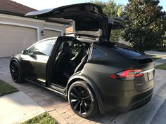 Tesla Model X Black Satin Gold Dust Vinyl Wrap with Carbon Fiber Accents on Chrome and all 6 seat backs. - Imgur
