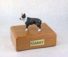 Pit bull figurine urn with custom wood base and personalized name plate.