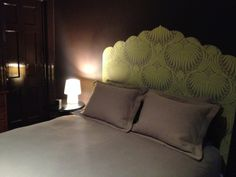 Ben Stearn's entry with a wallpaper headboard in Lotus BP 2047. We loved the imaginative use of lotus for a head board, especially against this dark backdrop
