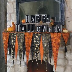 Bewitching Halloween Mantel Scarf and Happy Halloween Blocks ... to buy or to make? Could be a fun project!