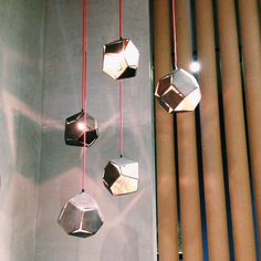 Philippines-based firm Industria produced these geometric pendants with red cords.
