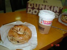 Raisin bagel with cream cheese and cookie and cream hot chocolate. ......heaven!