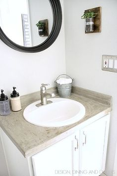 Budget Powder Room Makeover add waterproof baseboard around wall on vanity and seal with silicone