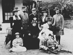 Queen Victoria with (l. to r.) Pss Helena Victoria of Schleswig-Holstein; Prince Henry of Battenberg; Count Arthur Mensdorff; Pss Henry of Battenberg; Dss of York w. Prince Edward; George, Duke of York; Pss Victoria Eugénie of Battenberg...